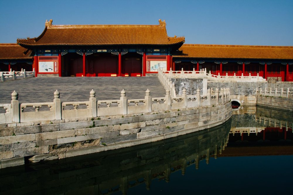 Forbidden City in Beijing - traditional Chinese building with red wood and golden roof