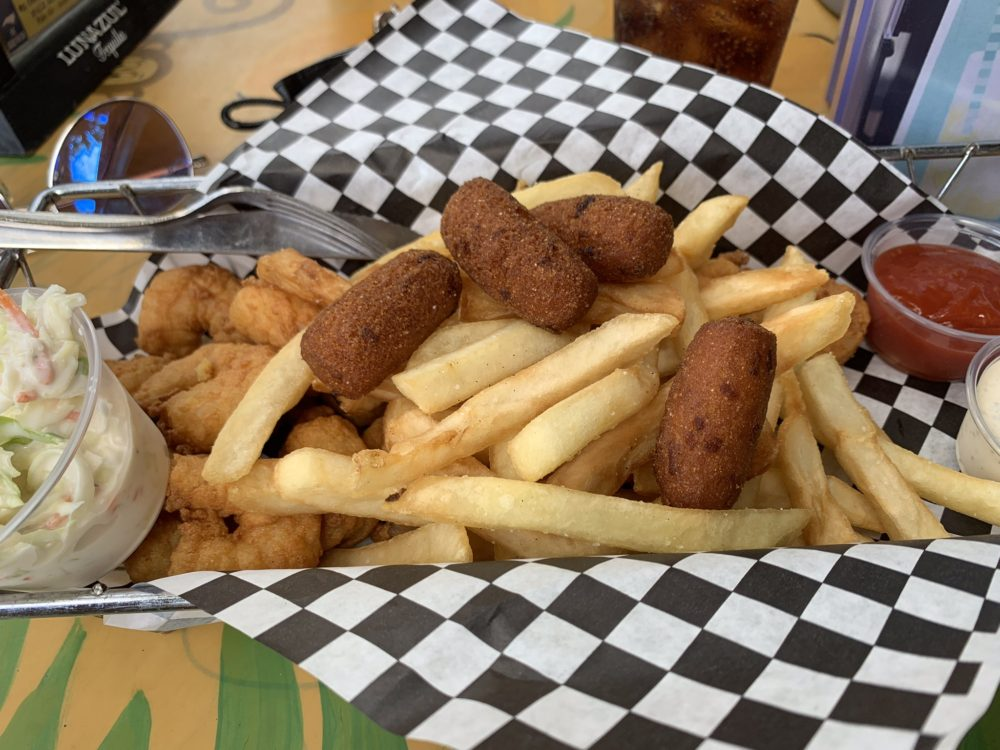 basket of fries, fried shrimp and hush puppies