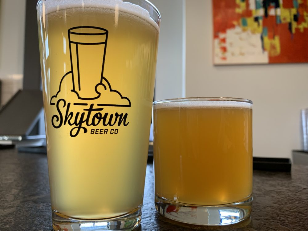 Pint glass beer next to half-pint with Skytown Beer Company logo, Wilmington, NC