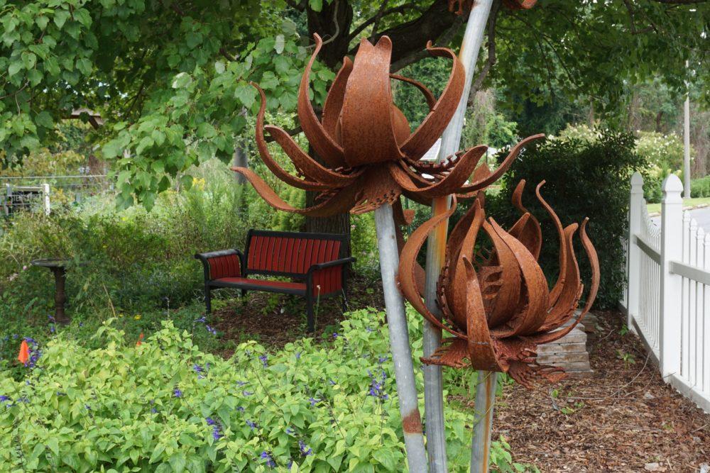 metal sculpture like flowers in Wilson Botanical Garden