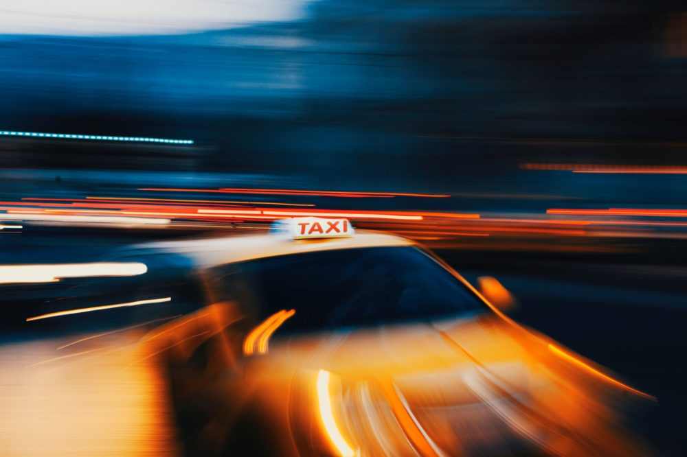 taxi blurred in night shot