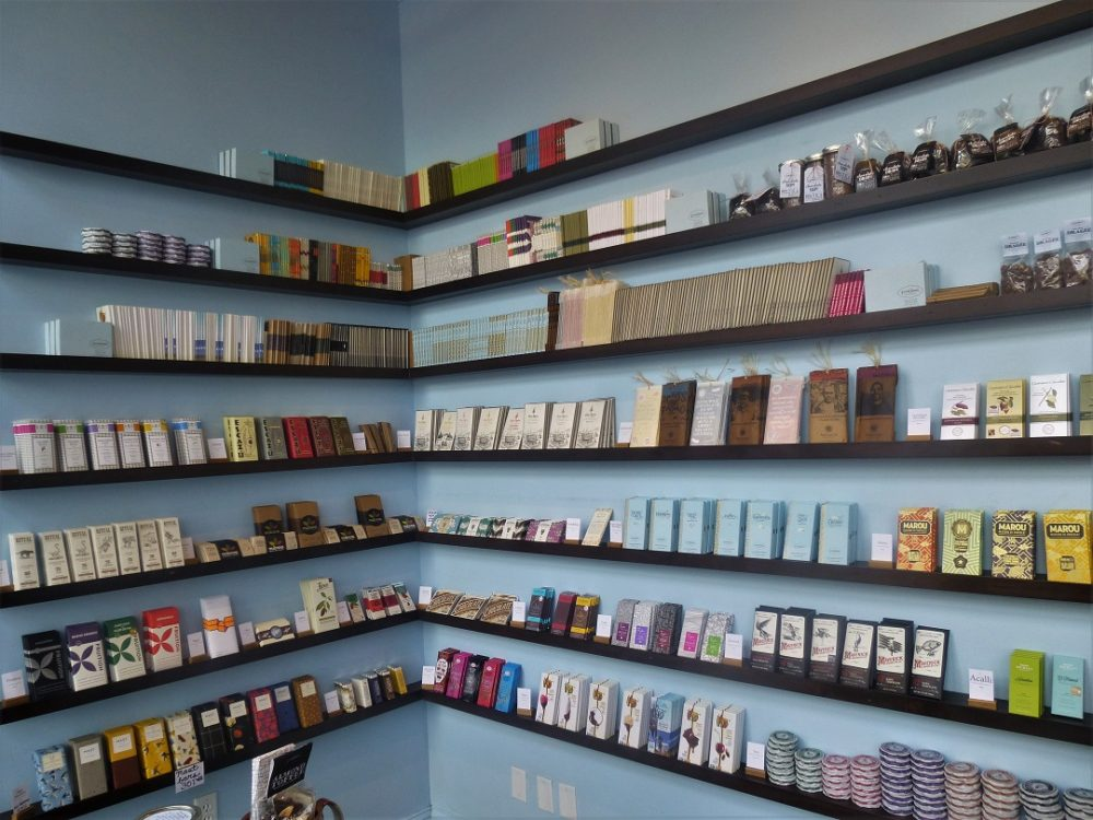 shelves with chocolate bars and products - French Broad Chocolate Lounge