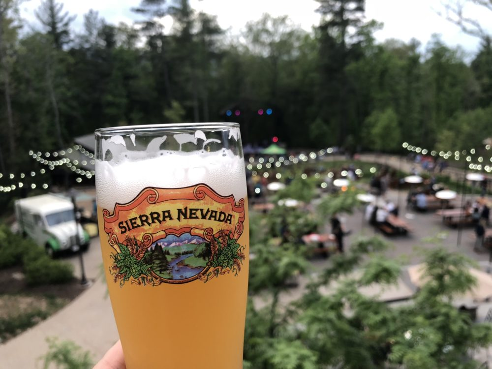 Sierra Nevada beer glass in forefront of brewery grounds