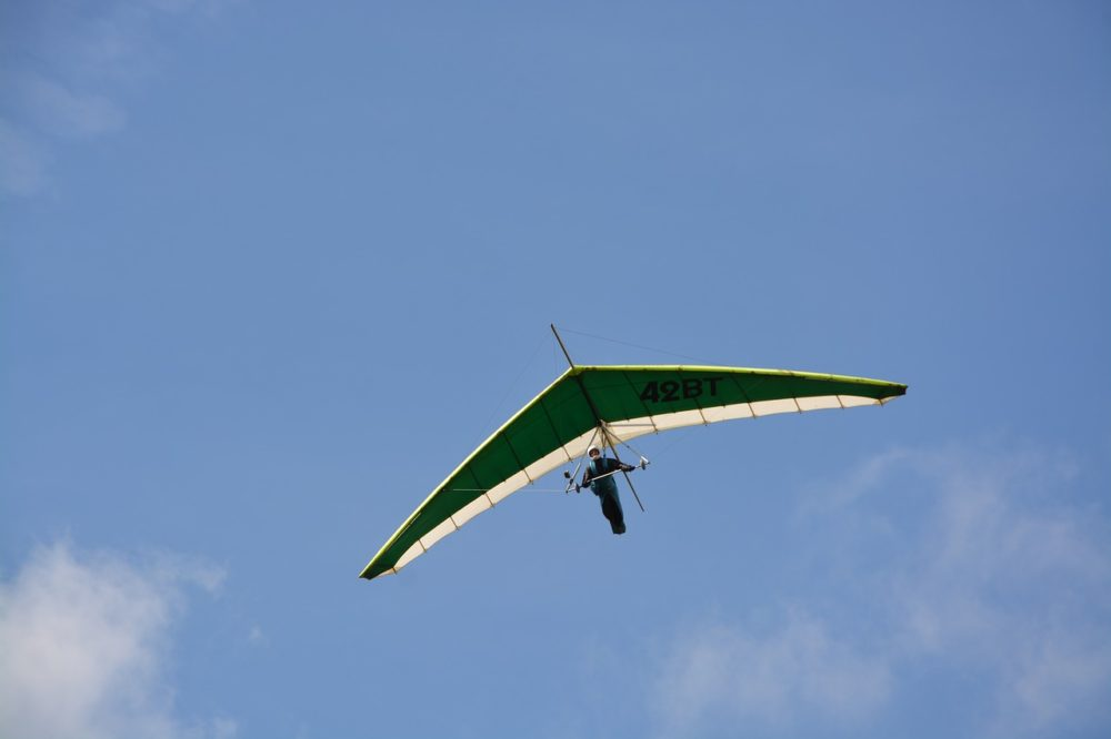 hang glider against blue sky