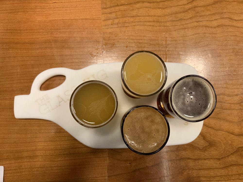 beer flight with board in shape of jug