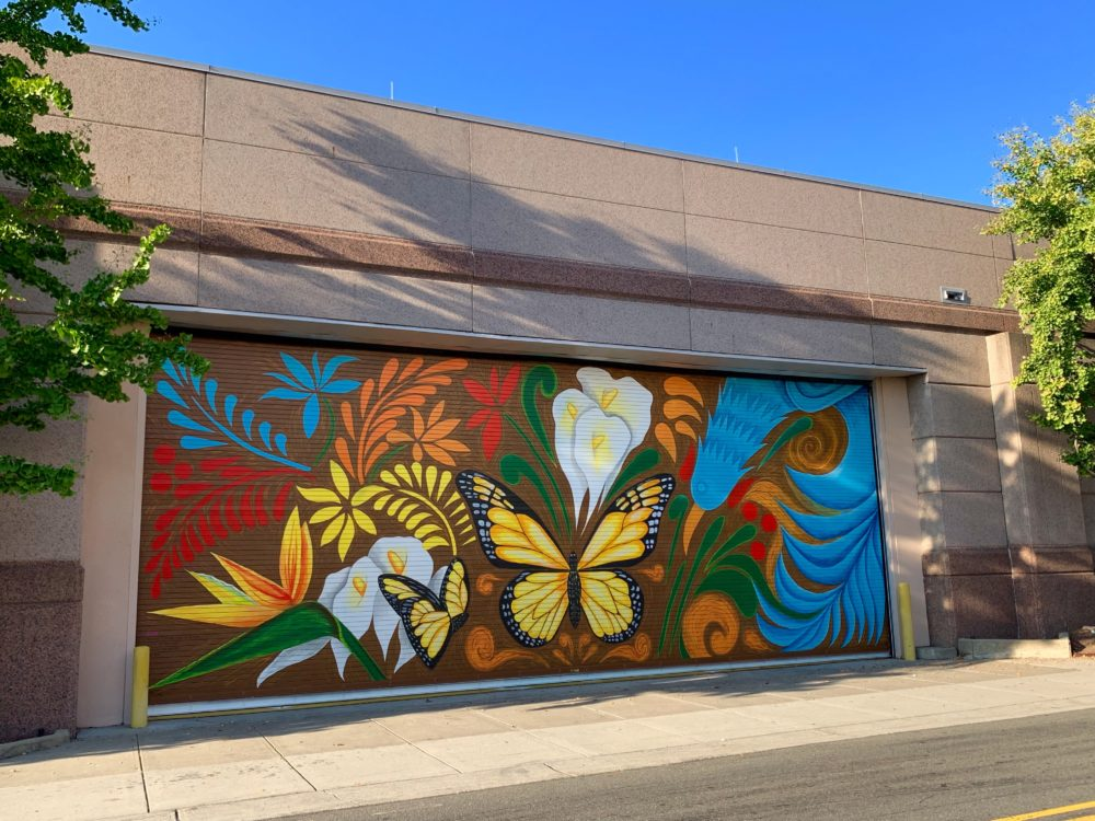 Frida Kahlo inspired mural in downtown Durham, NC with bright colors, butterflies and flowers