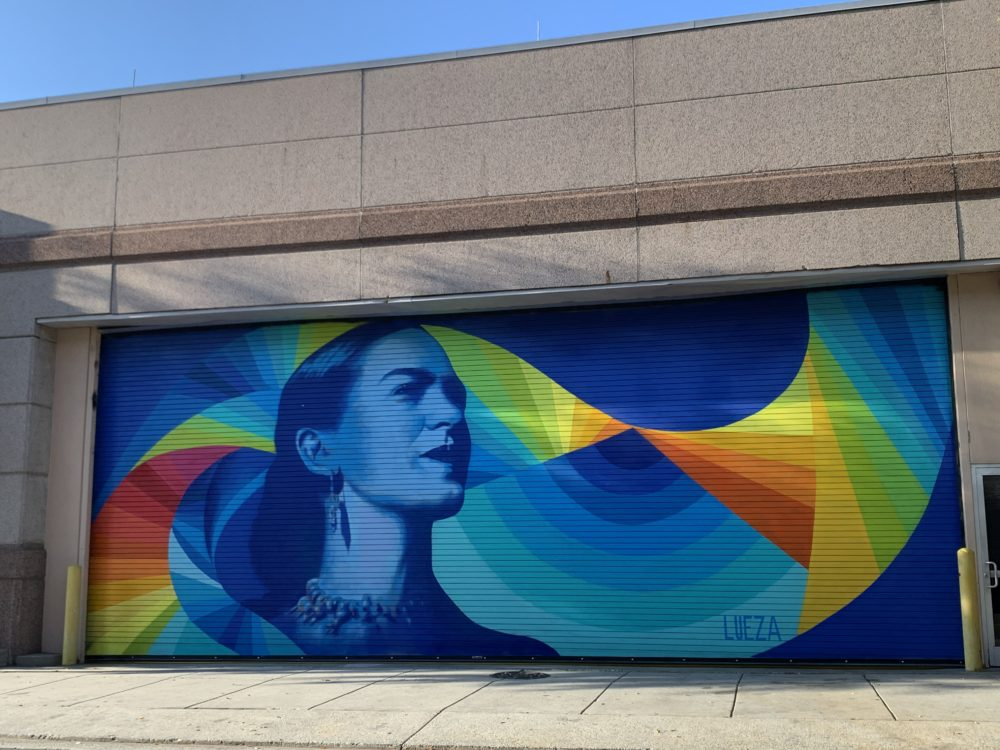Frida Kahlo mural with geometric shapes and bright colors - mural in downtown Durham, NC