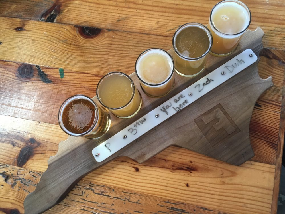 flight of beer from Fullsteam Brewery - board in shape of NC state