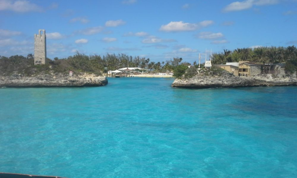 The Best Caribbean Cruise Shore Excursions to do on Port Day featured by top cruise blog, The Common Traveler: image of Entrance to Blue Lagoon Island - blue water