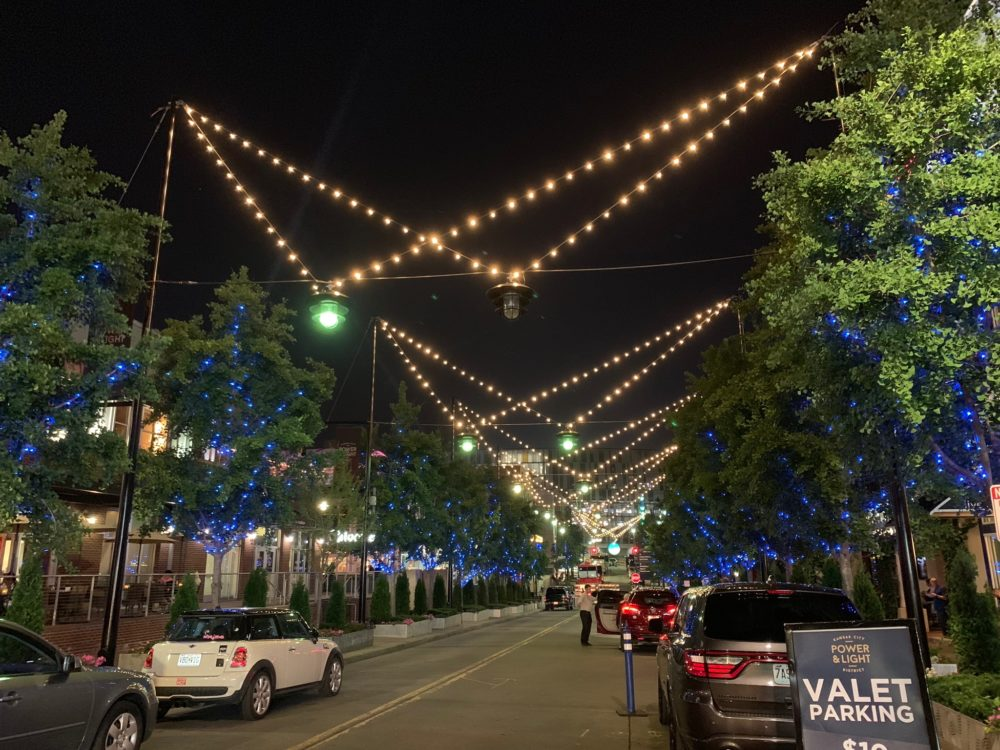 street in KC Power & Light District with twinkle lights above the street