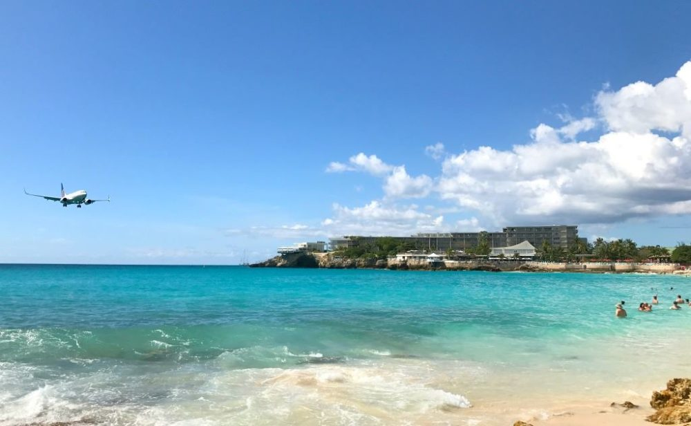 The Best Caribbean Cruise Shore Excursions to do on Port Day featured by top cruise blog, The Common Traveler: image of jet plane landing over Maho Beach, Sint Maarten