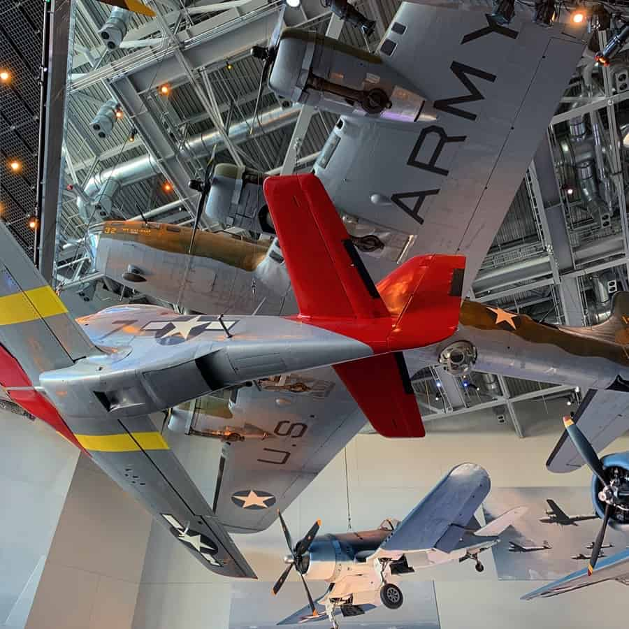 WWII airplane display hanging from ceiling at WWII Museum in New Orleans