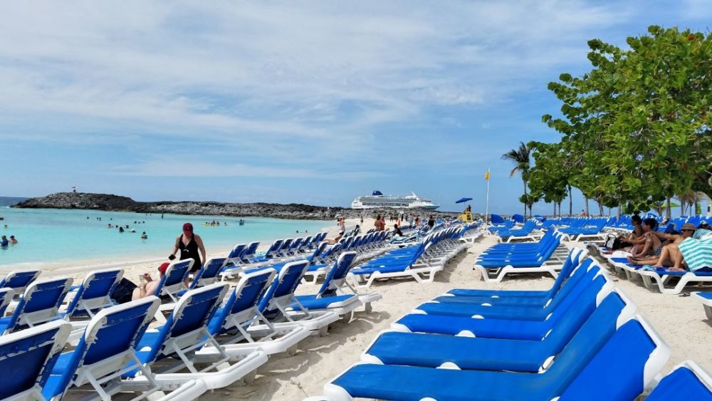 The Best Caribbean Cruise Shore Excursions to do on Port Day featured by top cruise blog, The Common Traveler: image of blue cushions on white sun chairs in Great Stirrup Cay