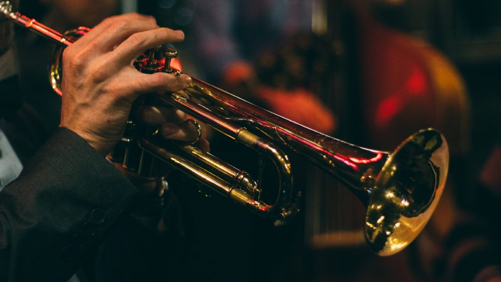 close up of musician's hand on trumpet