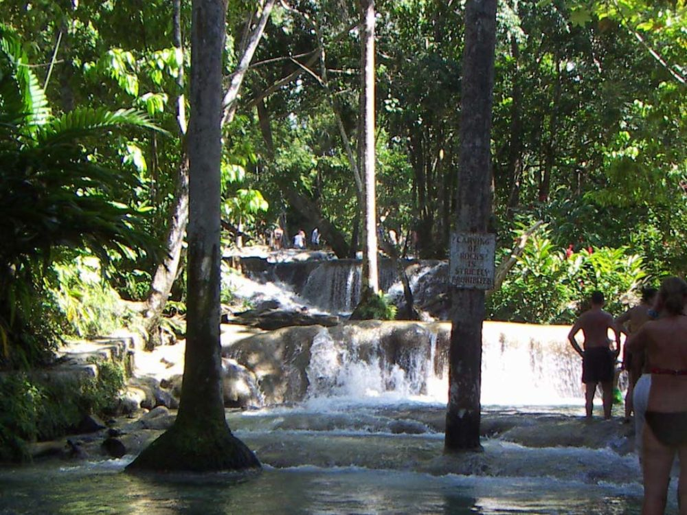 The Best Caribbean Cruise Shore Excursions to do on Port Day featured by top cruise blog, The Common Traveler: image of Dunns Falls in Jamaica