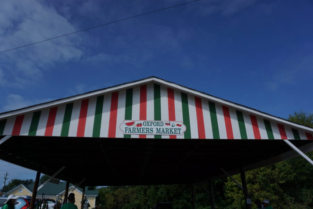 striped red, white and green awning for Oxford Farmers Market