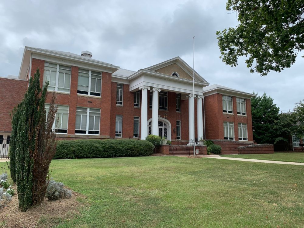 12 FUN THINGS TO DO IN OXFORD NC featured by top NC travel blog, The Common Traveler: image of old brick building with 4 white columns in front