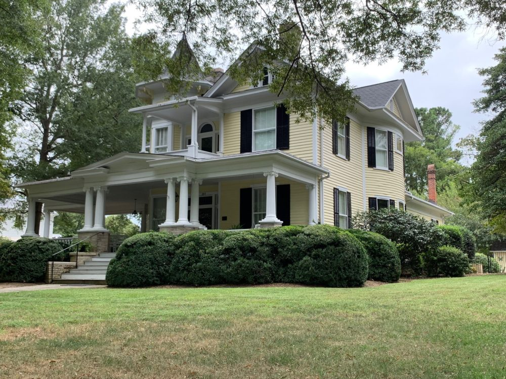 historic yellow home with white columns in Oxford, NC