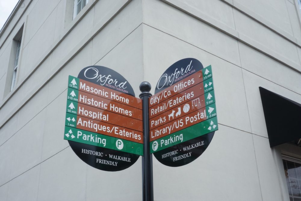street sign in Oxford, NC with historic signs