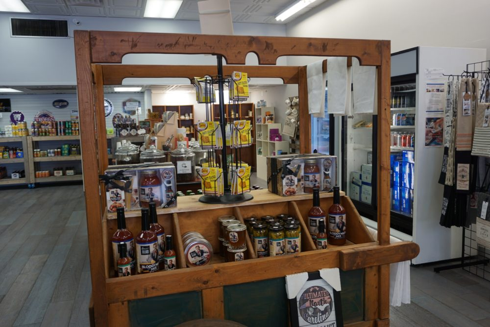 12 FUN THINGS TO DO IN OXFORD NC featured by top NC travel blog, The Common Traveler: image of display with local food items in The Hub on Main, Oxford, NC