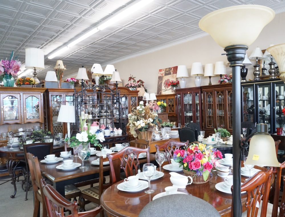 inside of store with dining tables and lamps