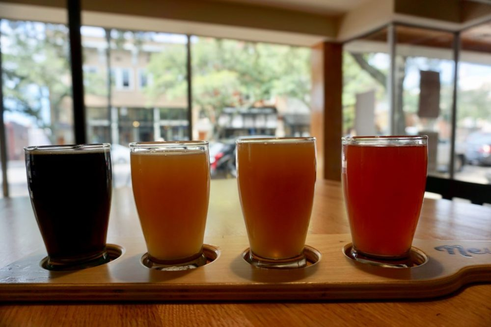 Ridgeline Craft Beverage Trail featured by top NC travel blog, The Common Traveler:  Flight of four beers at Newgrass Brewing Company