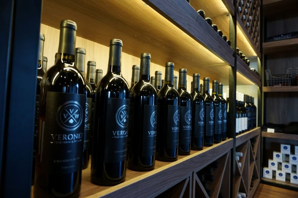 THE 7 BEST NORTH CAROLINA WINE TRAILS TO VISIT featured by top NC blog, The Common Traveler: ridgeline craft beverage trail: bottles of Veronet red wine lined up on shelves