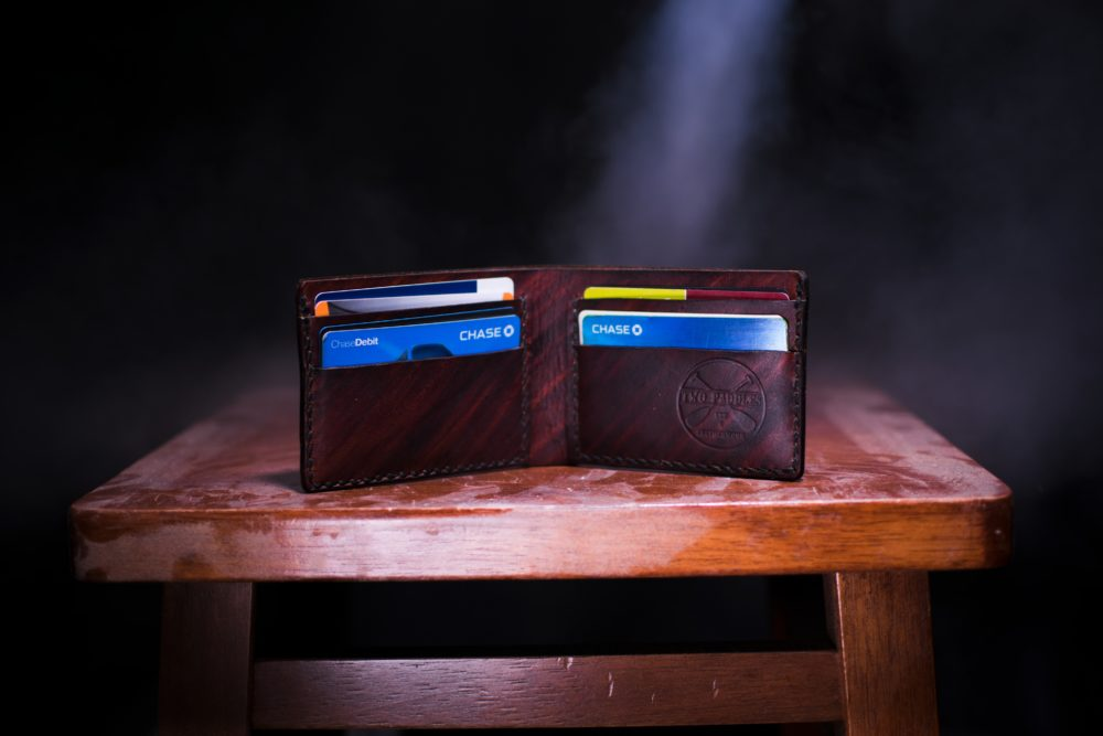 5 Essential Travel Hacking Tips for Beginners featured by top travel blog, The Common Traveler: image of wallet with credit cards to use in travel hacking