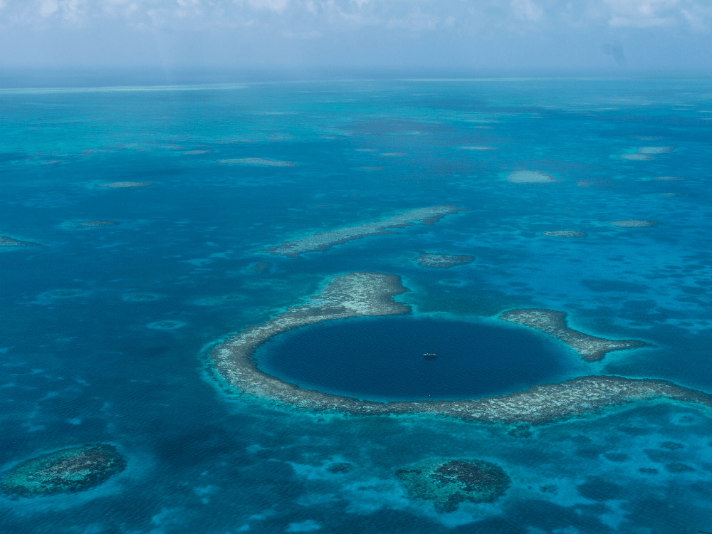 Top 10 Best Things To Do in Belize featured by top US travel blog, The Common Traveler: image of the Great Blue Hole in Belize