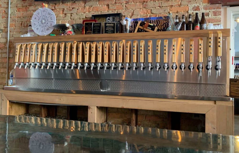 Best things to do in Goldsboro NC at the weekend, featured by top NC blog, The Common Traveler: image of beer taps at Goldsboro Brew Works