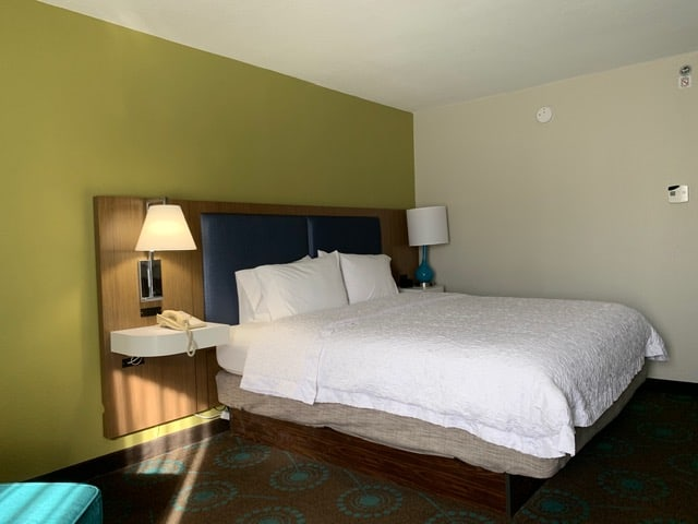 Best things to do in Goldsboro NC at the weekend, featured by top NC blog, The Common Traveler: image of Queen bed at Goldsboro Hampton Inn Hotel