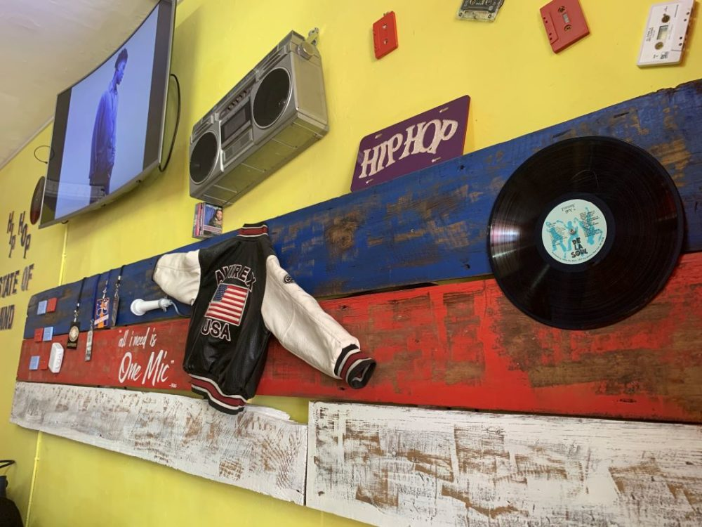 Best things to do in Goldsboro NC at the weekend, featured by top NC blog, The Common Traveler: image of Wall with Hip Hop memorabilia at The Ice Storm in Goldsboro, NC