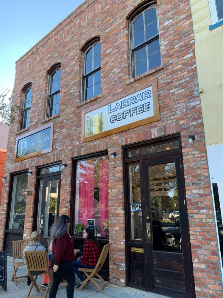 Best things to do in Goldsboro NC at the weekend, featured by top NC blog, The Common Traveler: image of Brick store front to Labrar Coffee in Goldsboro, NC