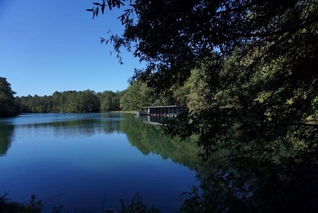 Best things to do in Goldsboro NC at the weekend, featured by top NC blog, The Common Traveler: image of Boat house and lake at Cliffs of the Neuse State Park in Wayne County, NC