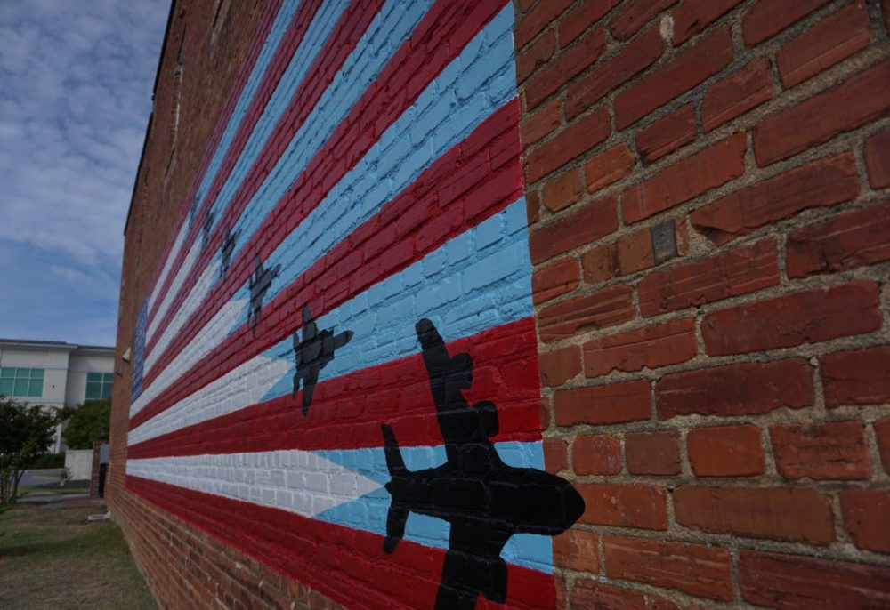 Best things to do in Goldsboro NC at the weekend, featured by top NC blog, The Common Traveler: image of mural of flag with jet planes in Goldsboro, NC