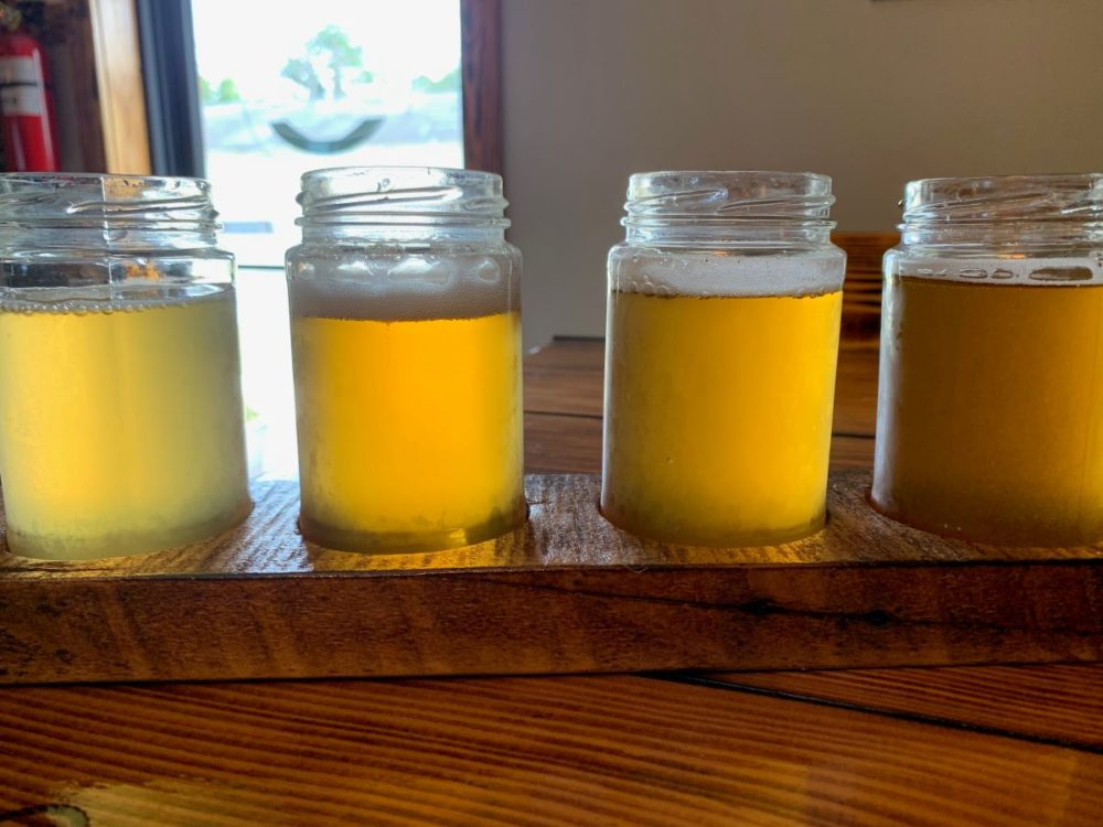 Best things to do in Goldsboro NC at the weekend, featured by top NC blog, The Common Traveler: image of R&R Brewing pickle jars with beer