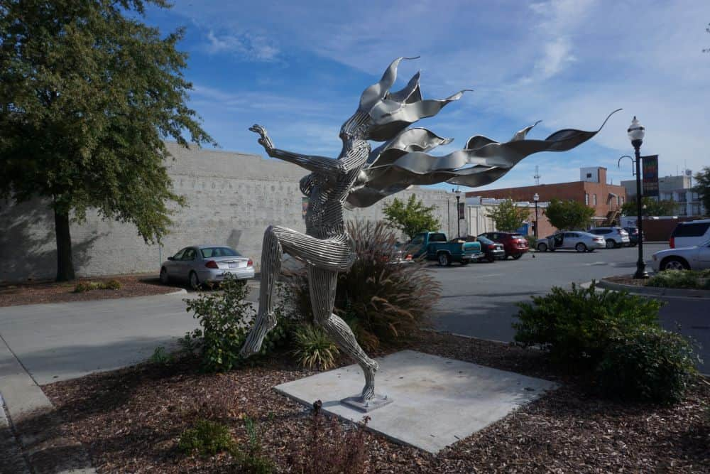 Best things to do in Goldsboro NC at the weekend, featured by top NC blog, The Common Traveler: image of metal dancing lady statue in Goldsboro, NC