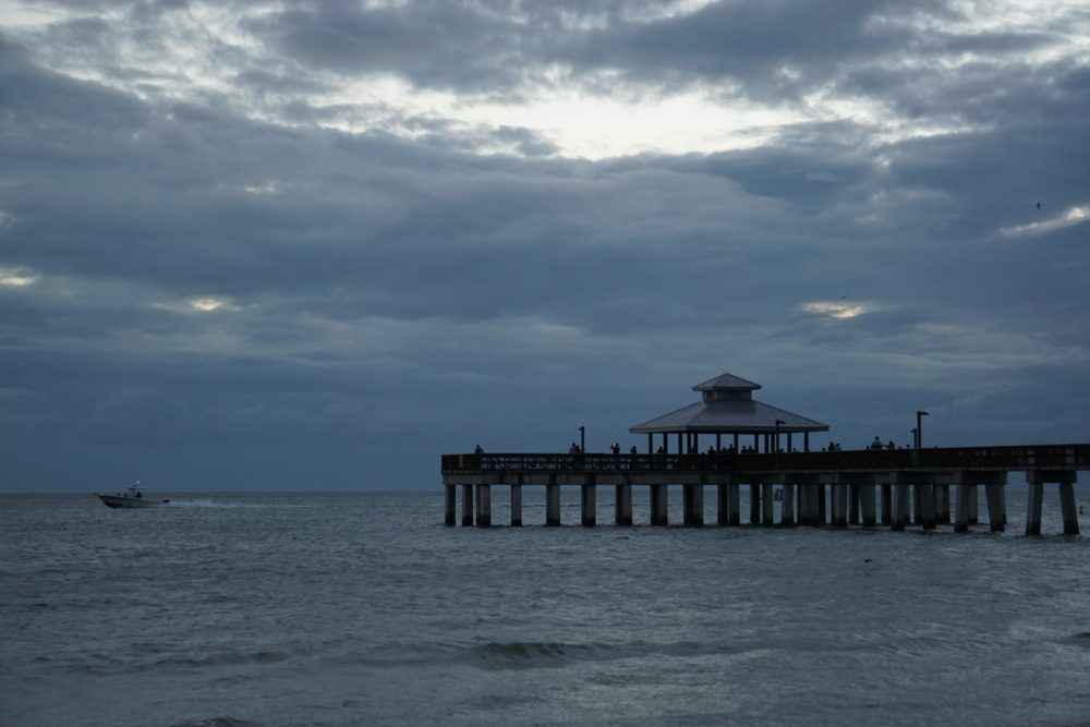 Top 5 best places to watch the sunset in SW Florida, featured by top US travel blog, The Common Traveler: image of pier at Fort Myers Beach
