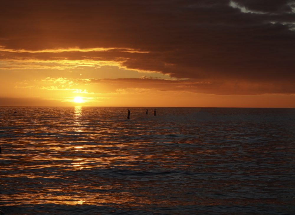 Top 5 best places to watch the sunset in SW Florida, featured by top US travel blog, The Common Traveler: image of sunset at Bonita Beach