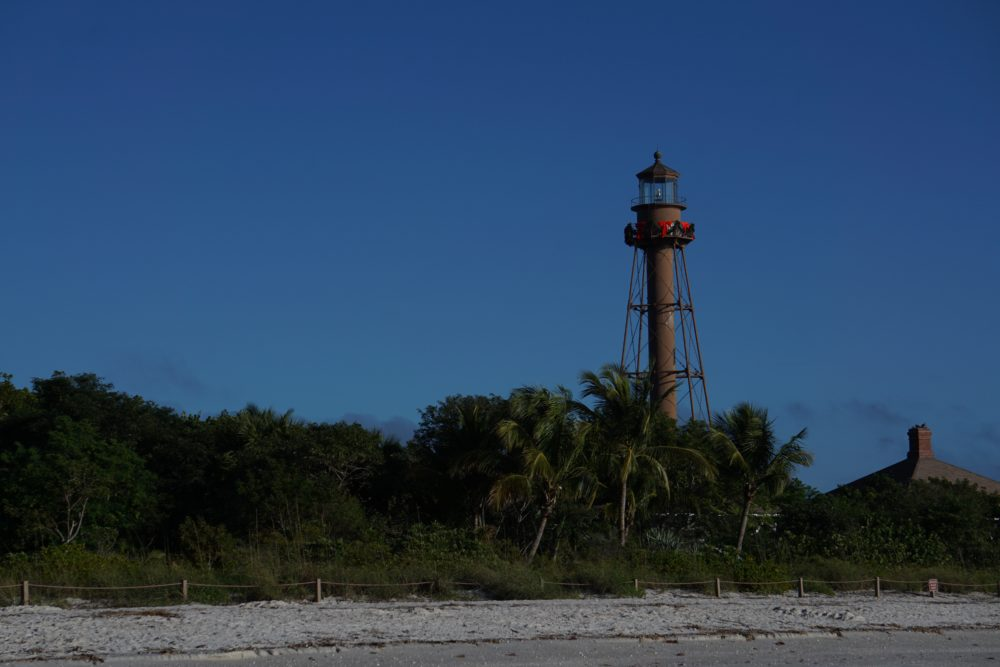 Top 5 best places to watch the sunset in SW Florida, featured by top US travel blog, The Common Traveler: image of Sanibel Island Lighthouse