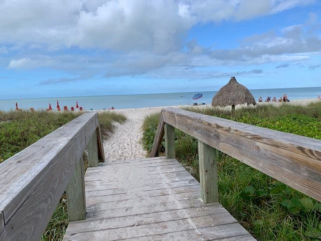 wood deck leading to lowdermilk beach state park in best naples, florida activities for outdoor lovers