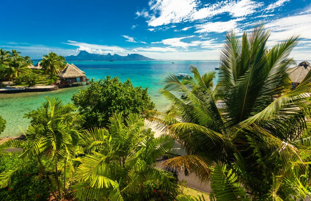 Best Honeymoon destinations in 2020 featured by top travel blog, The Common Traveler: image of  overwater bungalows in Tahiti