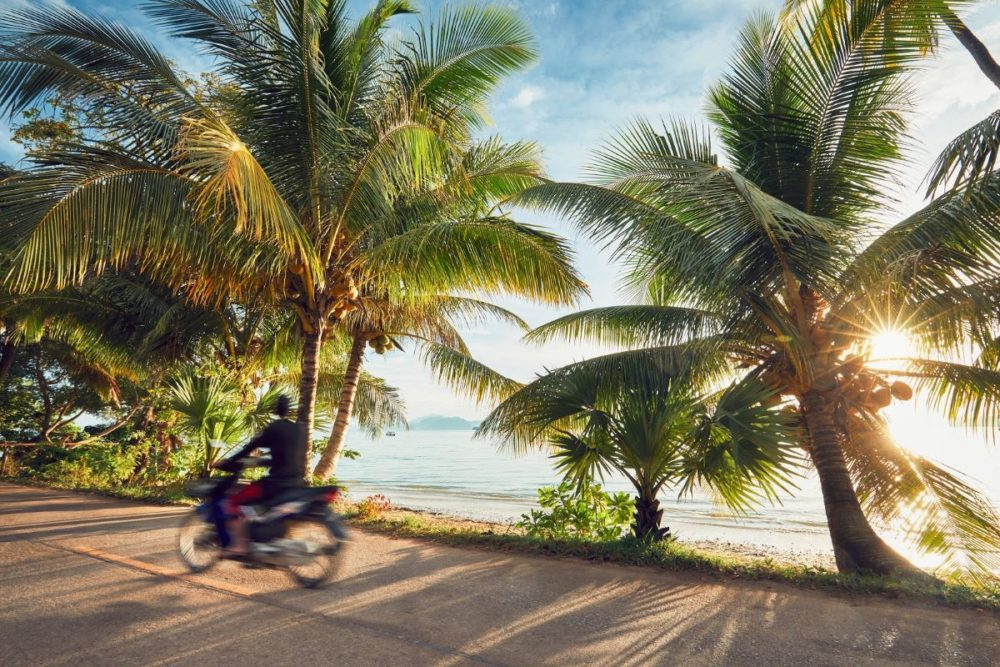 Best Honeymoon destinations in 2020 featured by top travel blog, The Common Traveler: image of motorcyclist on road in Thailand