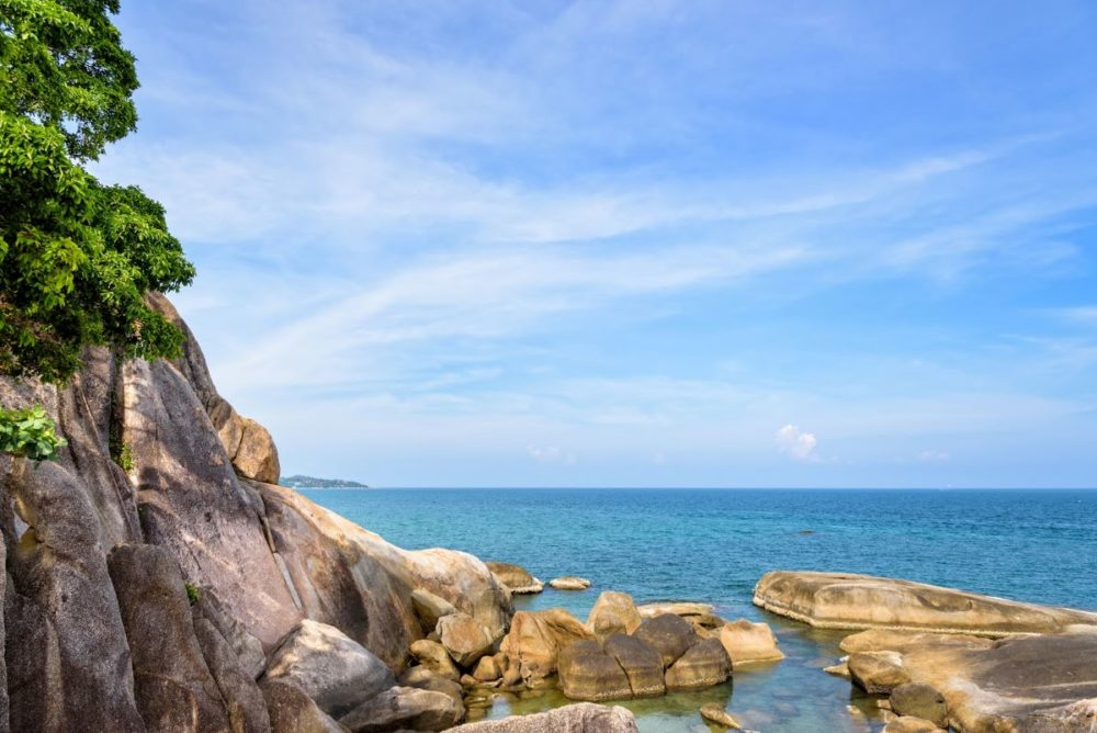 Best Honeymoon destinations in 2020 featured by top travel blog, The Common Traveler: image of  rocks with water in background at Koh Samui Island, Thailand