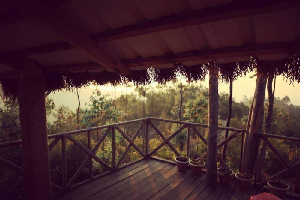 One month India itinerary featured by top travel blog, The Common Traveler. wooden platform with view of woods in Coorg