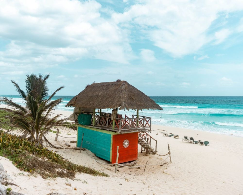 16 BEST PLACES TO VISIT IN MEXICO featured by top travel blog, The Common Traveler: image of lifeguard shack on beach in Cozumel, Mexico
