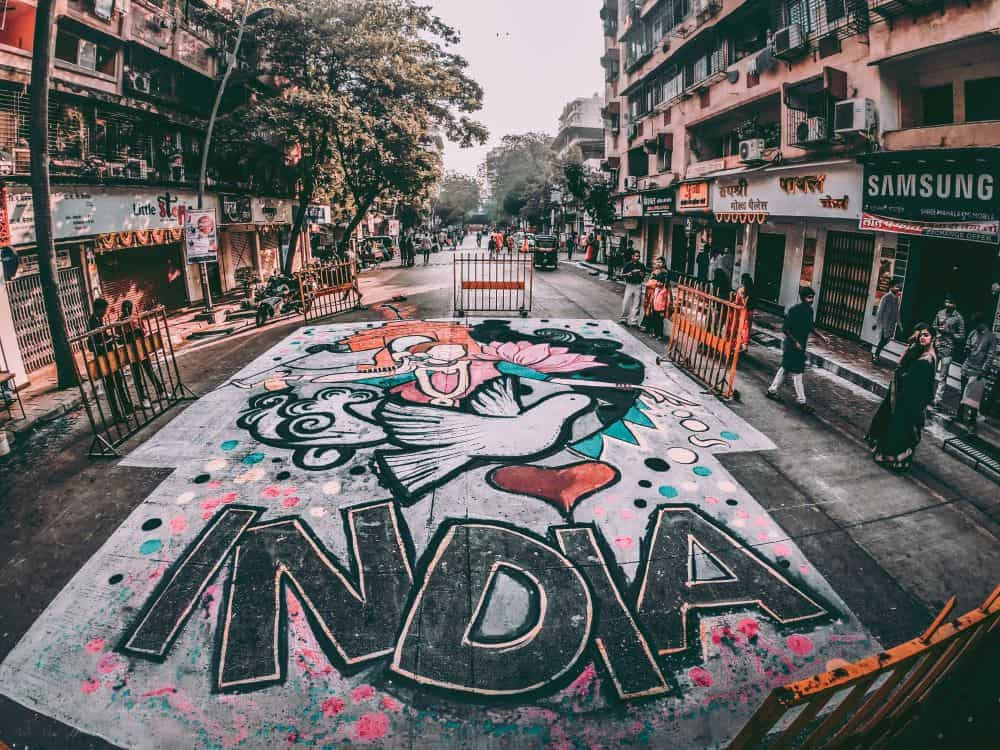 One month India itinerary featured by top travel blog, The Common Traveler. Image - India sidewalk art on street.