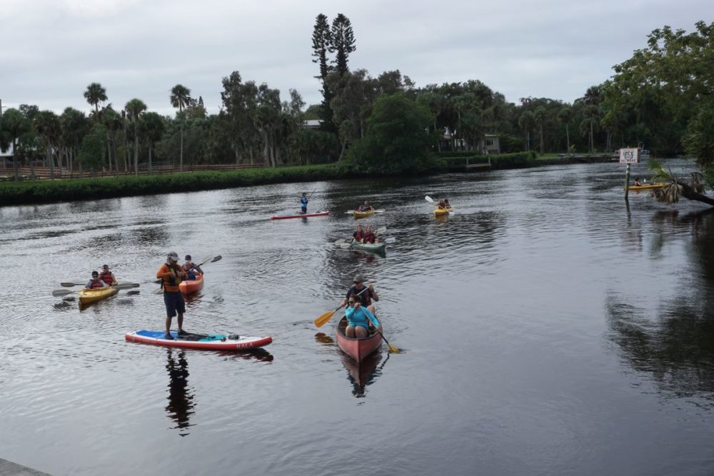 Best things to do in Fort Myers, Florida featured by top US travel blog, The Common Traveler: image of people in kayaks and paddle boards at Manatee Park in best things to do in Fort Myers today