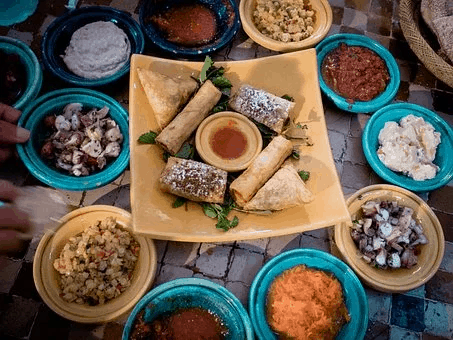 TOP 5 BEST FOOD CITIES IN THE WORLD FOR FOODIES IN  2020 featured by top travel blog, The Common Traveler: image of moroccan dishes of food