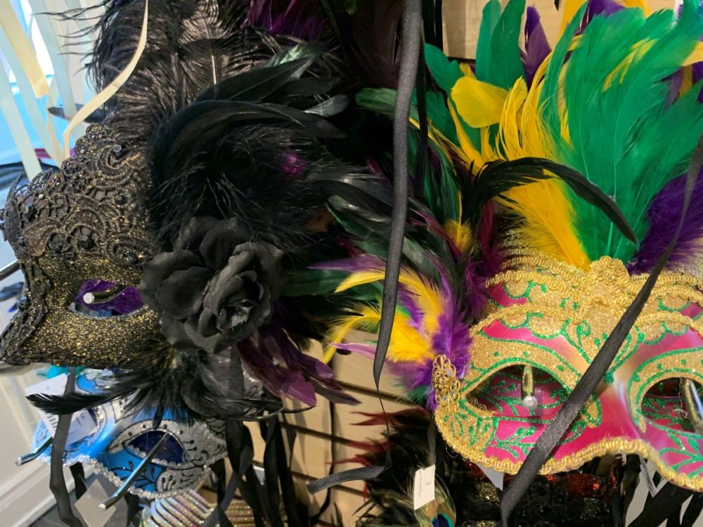 best souvenirs from New Orleans featured by top US travel blog, The Common Traveler: image of masks with feathers from mardi gras